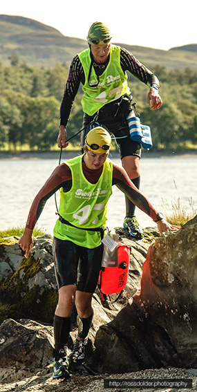 Runners with a towline, pull buoy and various other SwimRun gadgets!